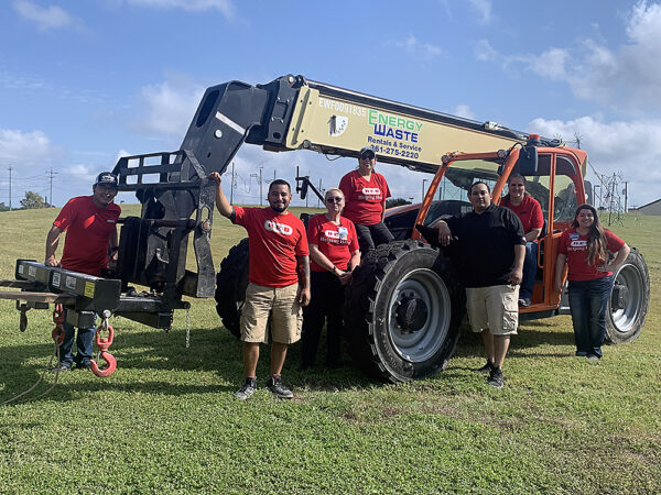 H-E-B volunteers posing with lift (contributed by Energy Waste) used for placing scenes in Cuero's Christmas in the Park
